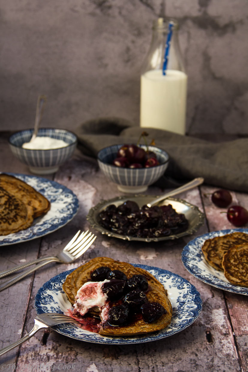 Buckwheat pancakes served with cherry sauce and Greek yogurt