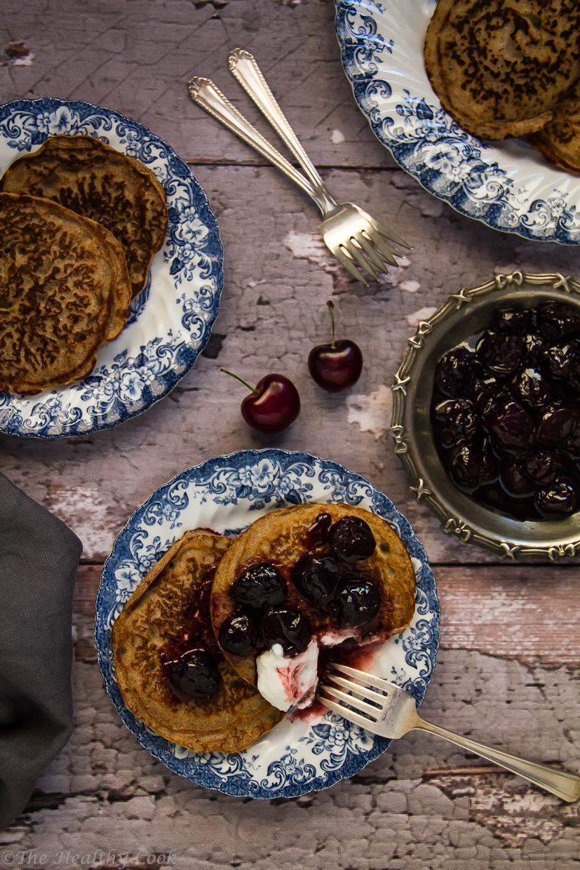 Buckwheat pancakes served with cherry sauce and Greek yogurt